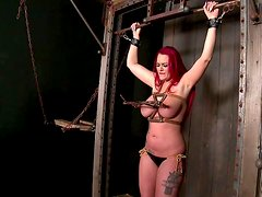 Redhead slut is tormented in BDSM sex video